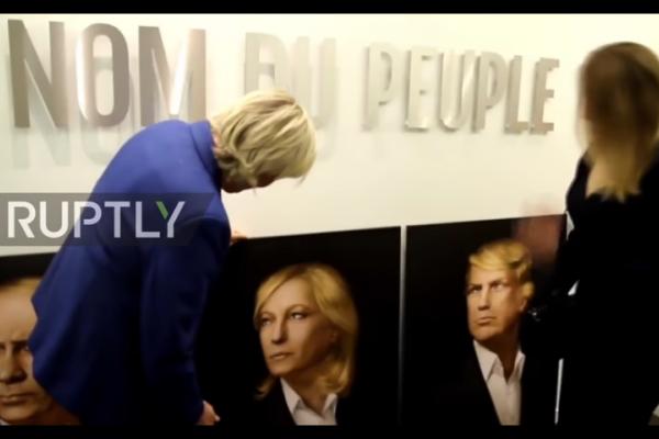 نشطاء روس يهدون لوبان لوحة تجمعها ببوتين وترامب